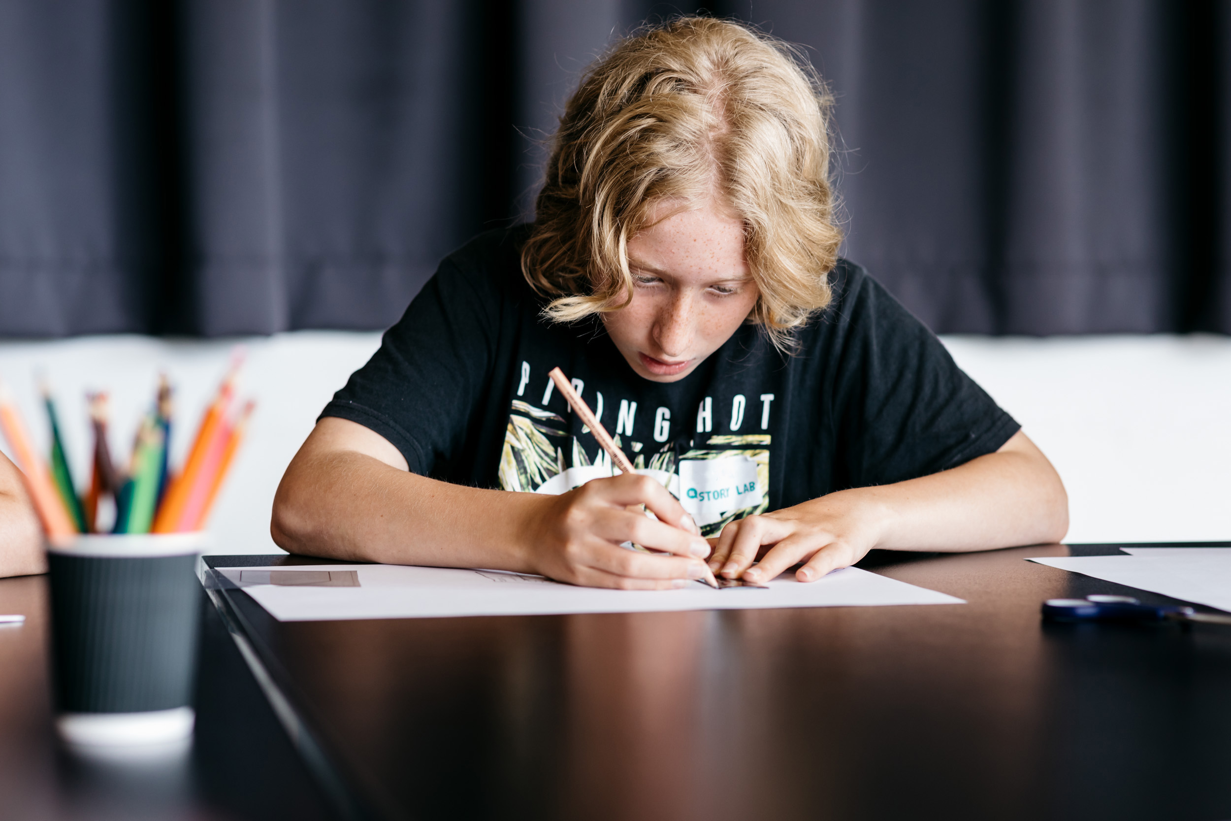 Teenager creating a book