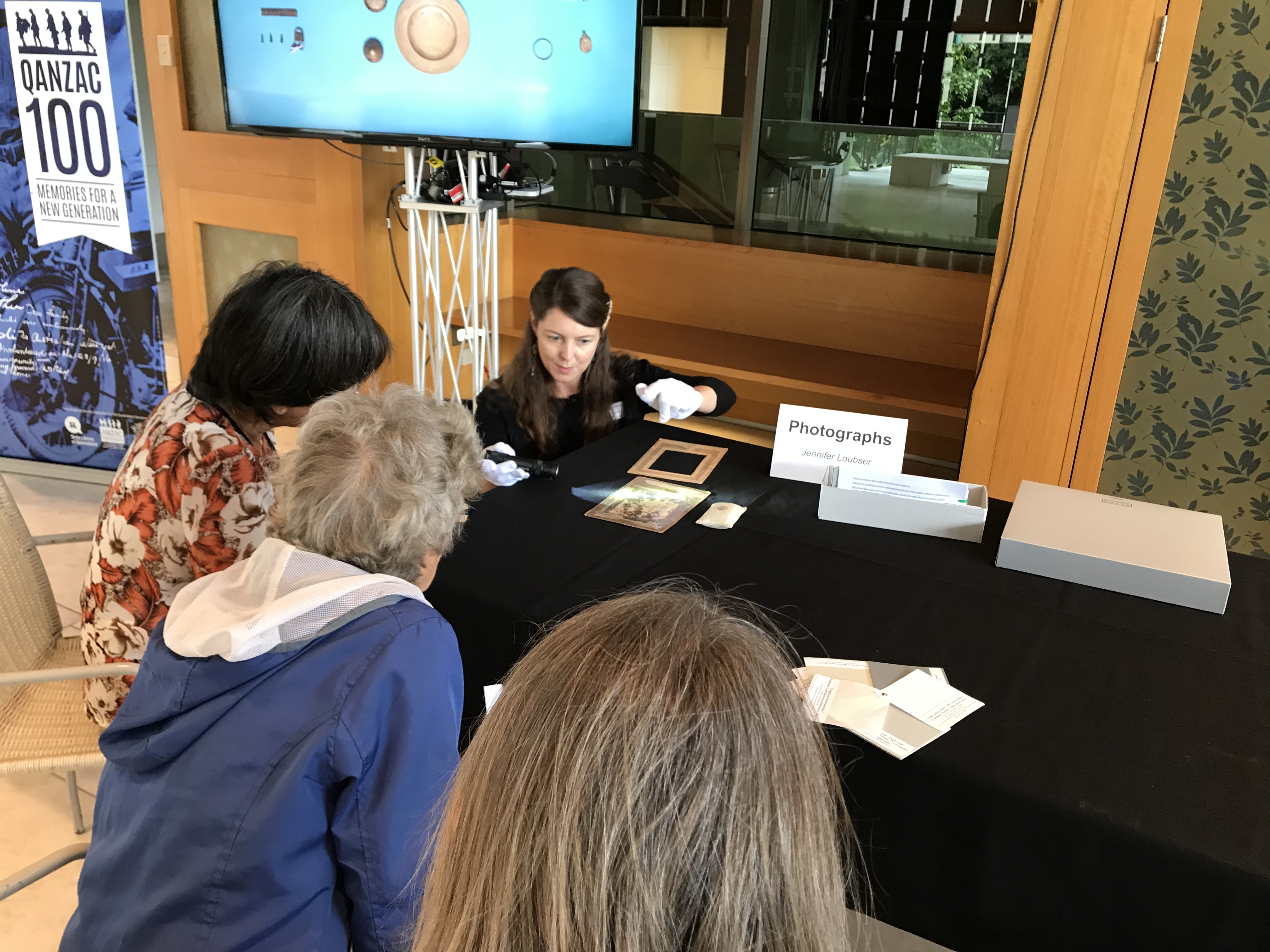 State Library conservator providing advice on caring for family photographs