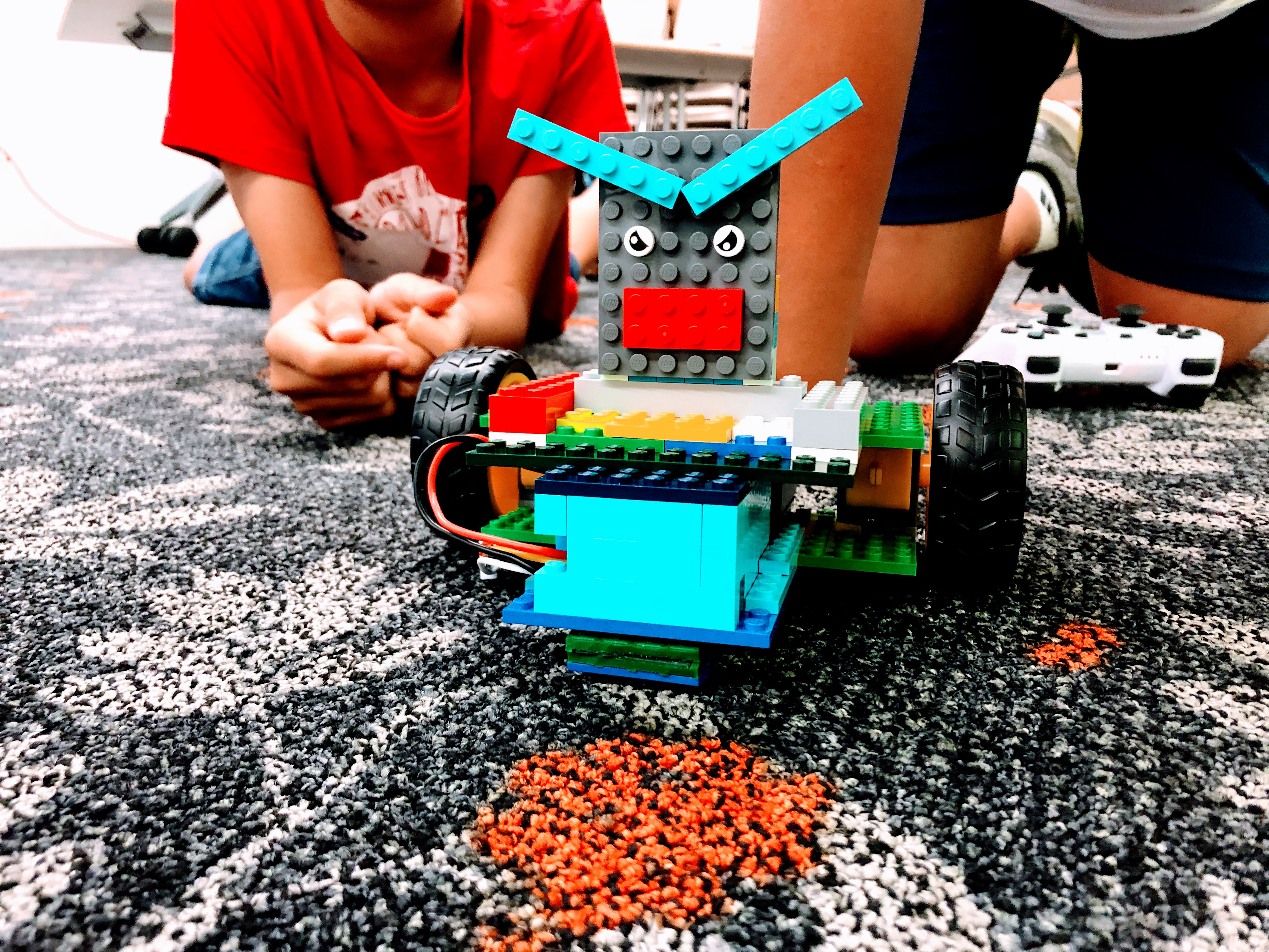 Young people with a custom built Lego robot