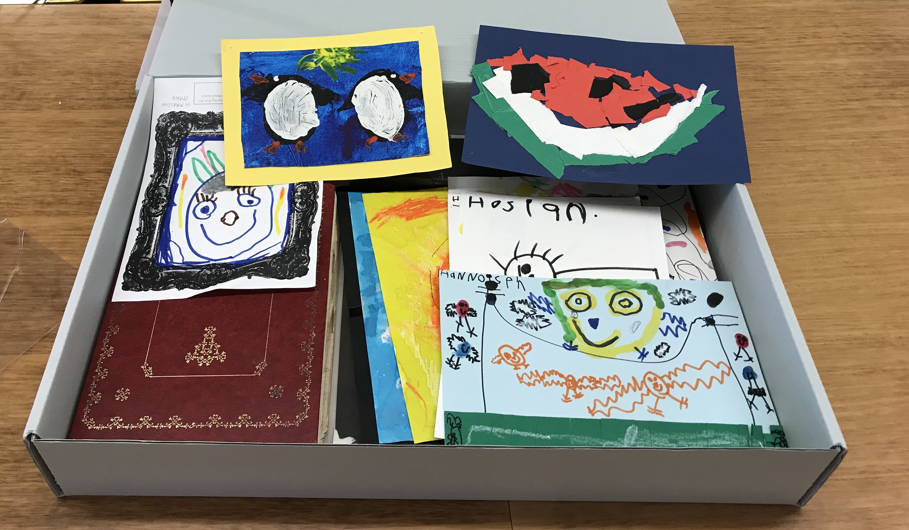 Childrens Artwork in storage box