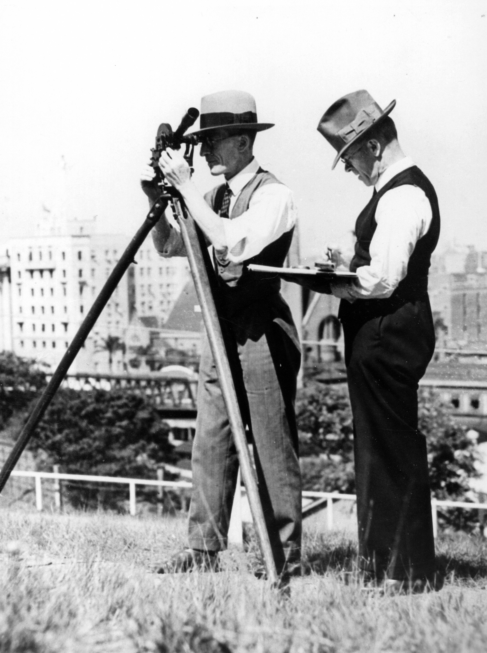 Two meteorologists registering information using their recording equipment, ca.1937