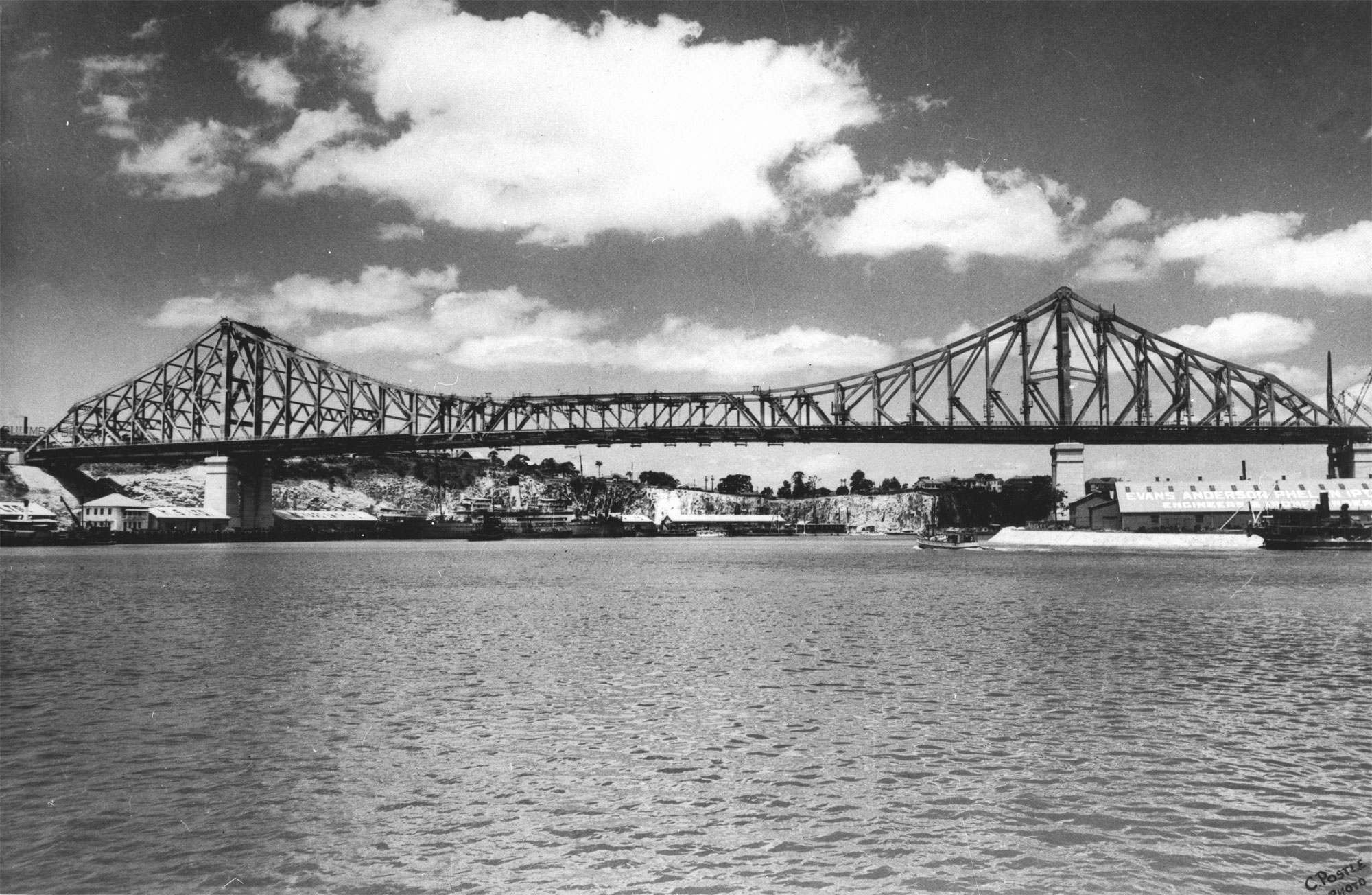 Brisbanes Story Bridge 1940 The 281 metre cantilever bridge was built between19351940 constructed by Evans Deakin - Hornibrook Pty Ltd The premises of Evans Anderson Phelan Pty Ltd Engineers at Kangaroo Point are visible on the right The New Farm cliffs can be seen in the background The bridge connected Fortitude Valley and the southside suburbs It is heritage listed and now carries 30 million cars per year 16 bridges cross the river but the Story Bridge remains the grandfather of them all