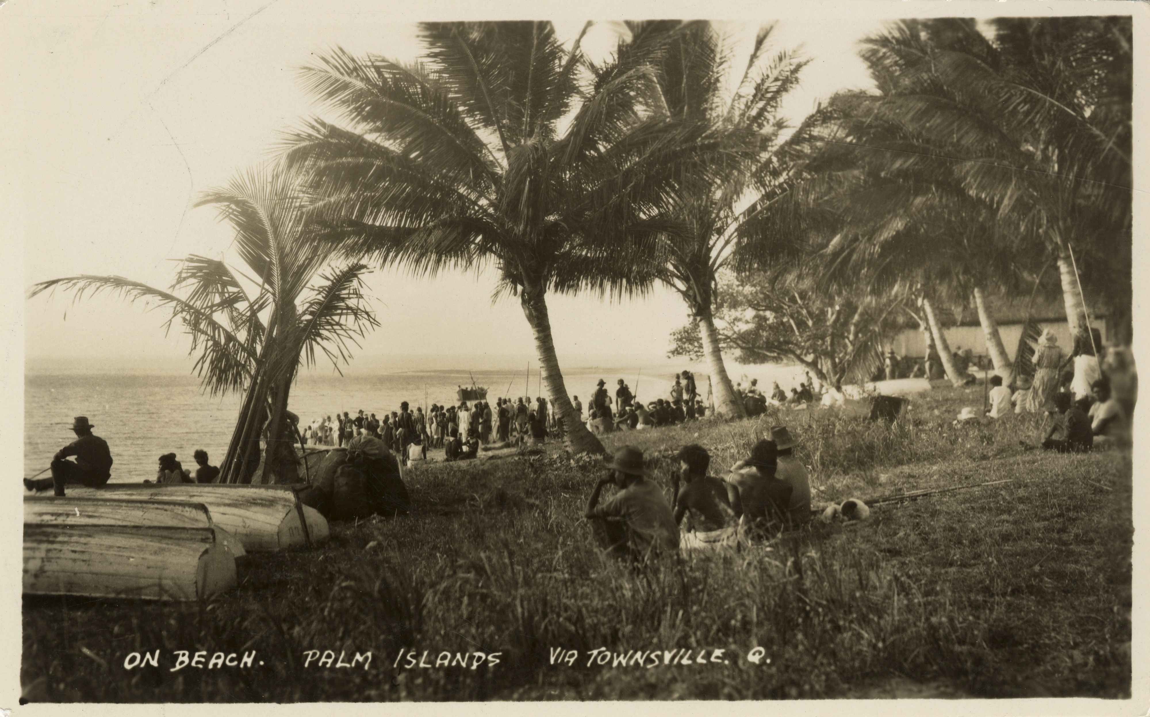 Crowds gathered on the beach at Palm Island, Queensland