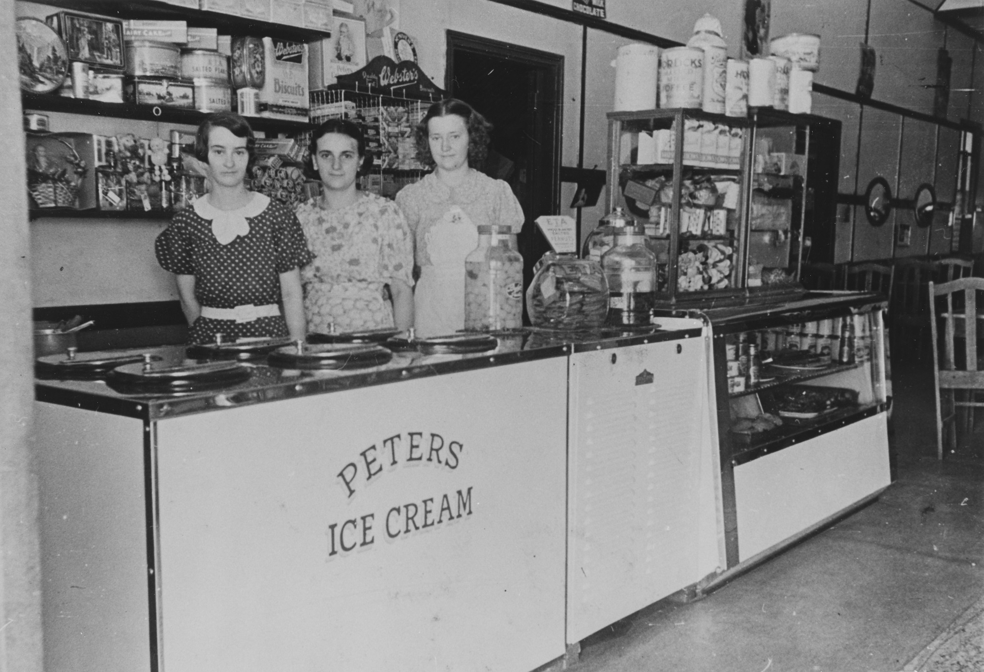 Three woman standing at Peters Ice Cream counter in cafe