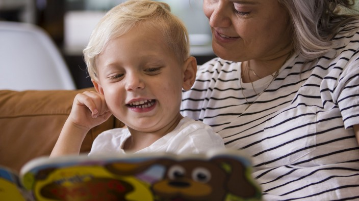 Mother and son reading his favourite book again