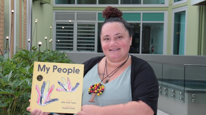 My People book held up by author Billie-Jean Taylor