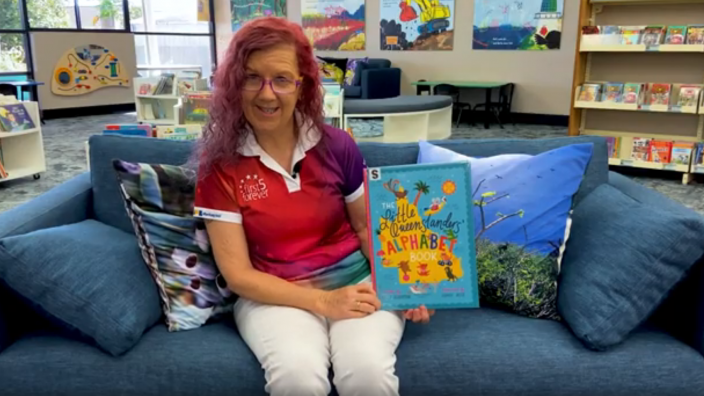 Librarian reading a book at a story time session