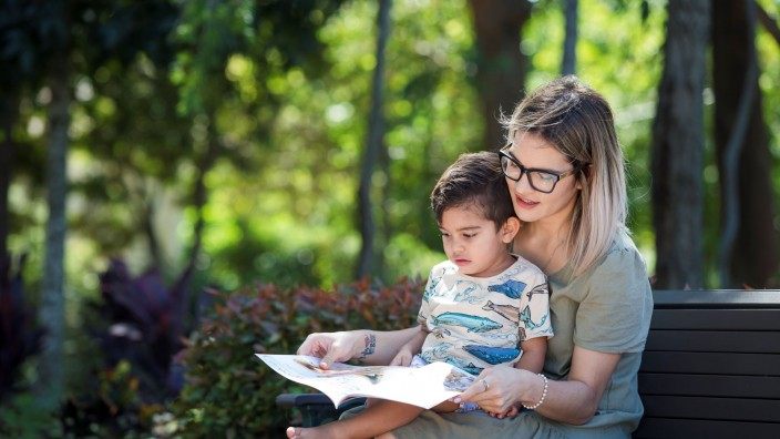 Mother and son reading at the park