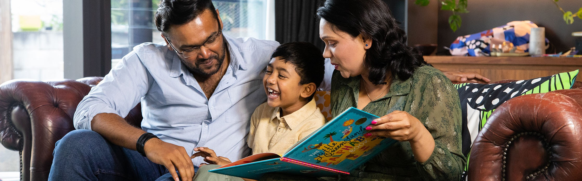 Family reading to child