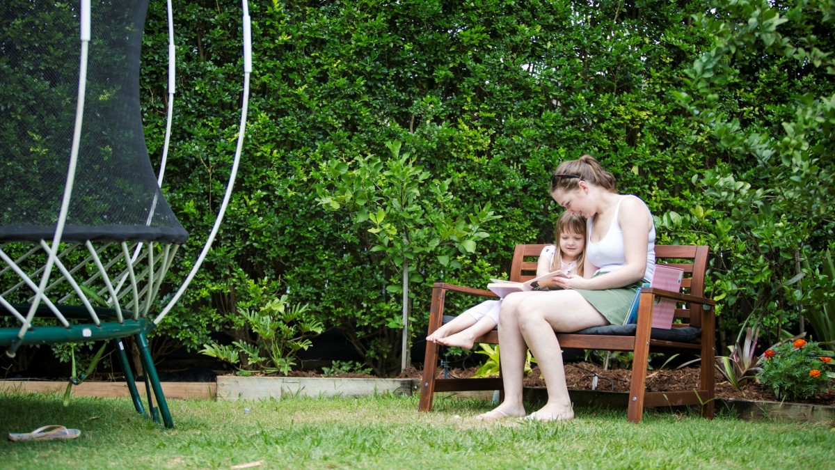 Mother and child reading in the garden
