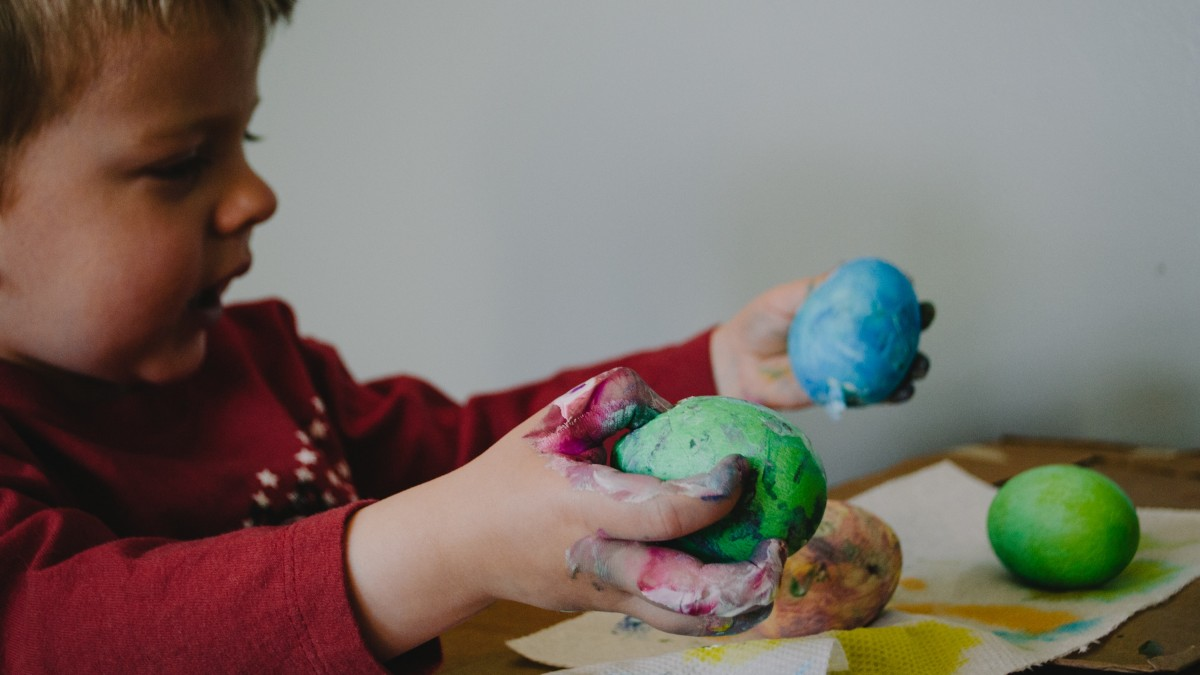 Child playing with play-dough inside