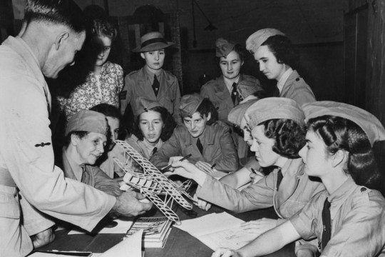 Group of women members of the RAAF gathered around a table learning aviation basics October 1941