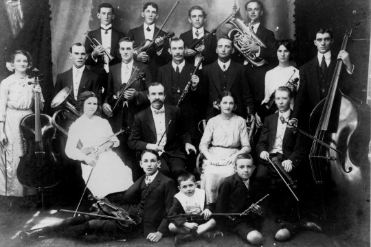 Image of orchestra members with instruments