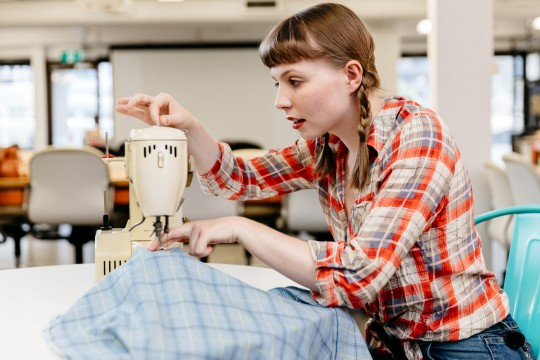 Teenager sewing