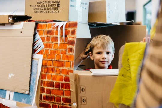 Boy in a cardboard construction