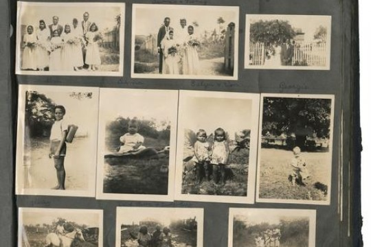 Photographs of Aboriginal children and a wedding in a photograph album