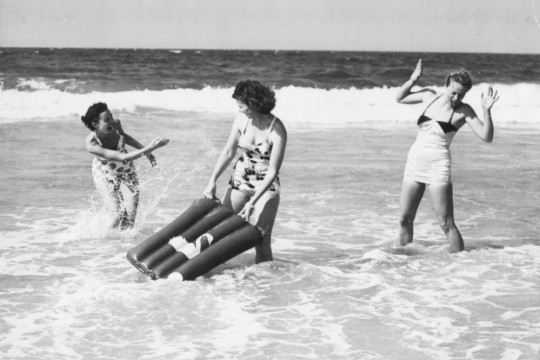 Young women modelling for an advertisement at Surfers Paradise, 1951