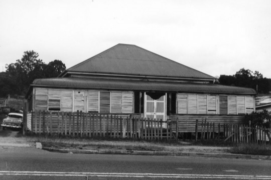 Image of Queenslander house with car in driveway c.1960-70