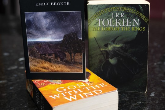 The books Wuthering Heights The Lord of the Rings and Gone with the Wind stacked on a counter