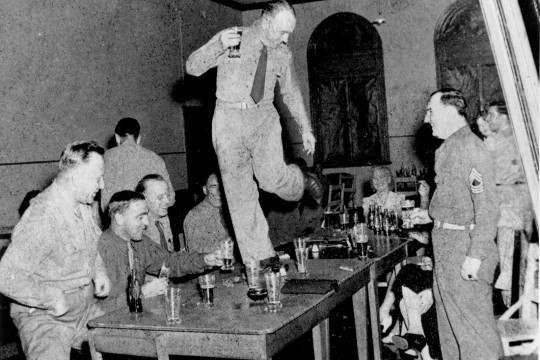 An American soldier dances on the table at Eagle Farm Brisbane in the 1940s