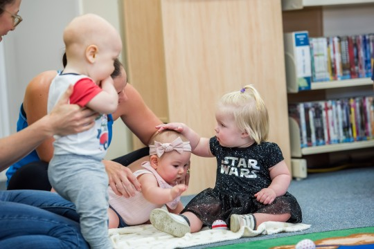 Babies attend a Baby Play session at a library in Mackay