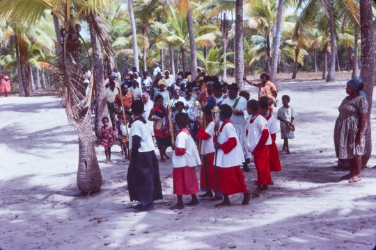 The people of Badu prepare for the Coming of the Light parade in Badu Island Torres Strait in the late 1970s