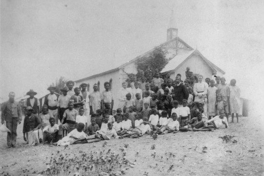 Large group of people gathered outside the church at Batavia River Mapoon 1904