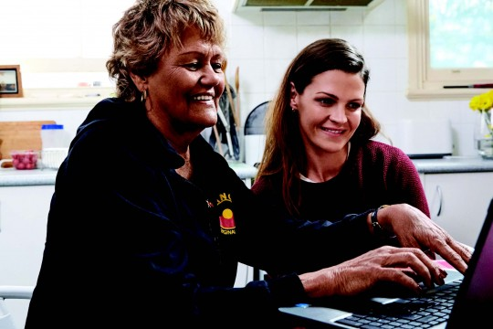 Two women using computer