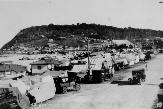 The Esplanade at Burleigh Heads crowded with tents and cars during Christmas holidays 1932 Tents have been erected along the road and on the beach turning the Esplanade in to a camping site