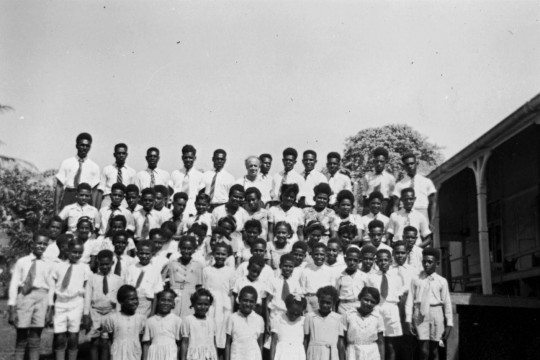 A group of Torres Strait Islander children standing outside