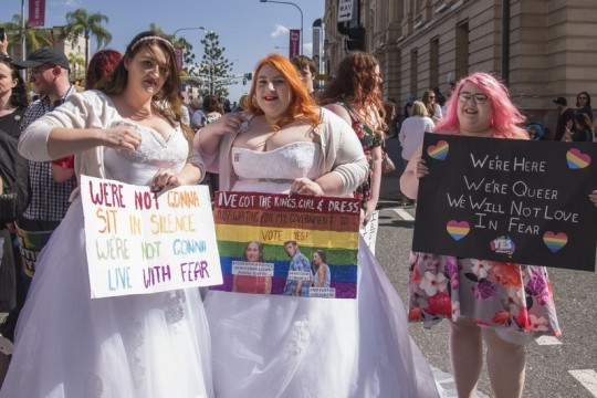 Demonstrators wearing wedding gowns at Marriage Equality Rally Brisbane