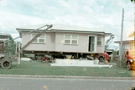 House being jacked up for removal ca1959 Charles Busch John Oxley Library SLQ MMS ID 99183339720702061
