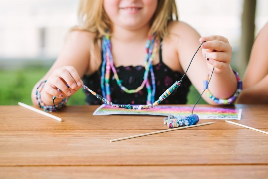 A child participating in Jemima Wymans Paisley beads  activity 2014  Photograph Katie Bennett