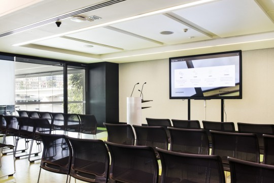 The Innovation Lab with podium and large screen
