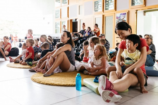 Parents and children as enjoying storytelling performance