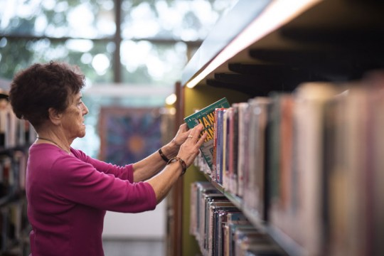 Client browsing books in the Caboolture public library.