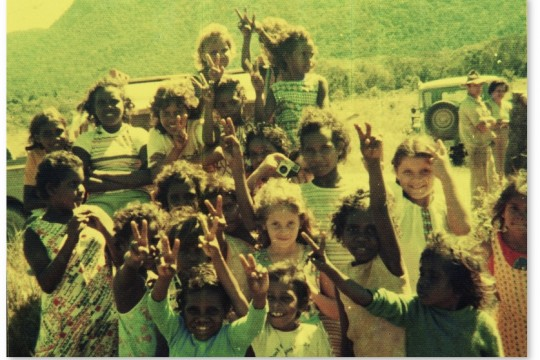 Children from Bloomfield River region waving to the camera