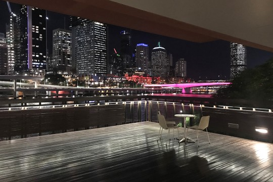 River deck overlooking the city skyline at night