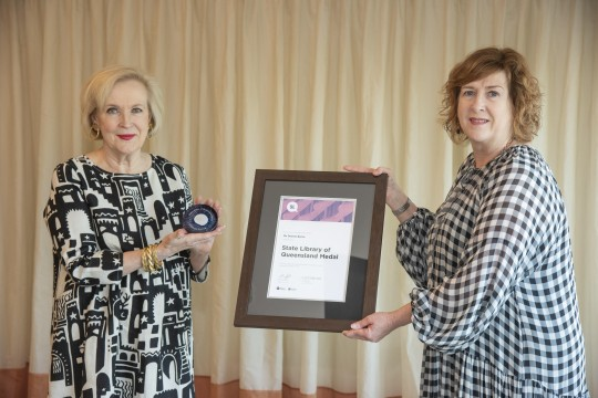 State Librarian Vicki McDonald presenting Dianne Byrne with the State Library of Queensland Medal
