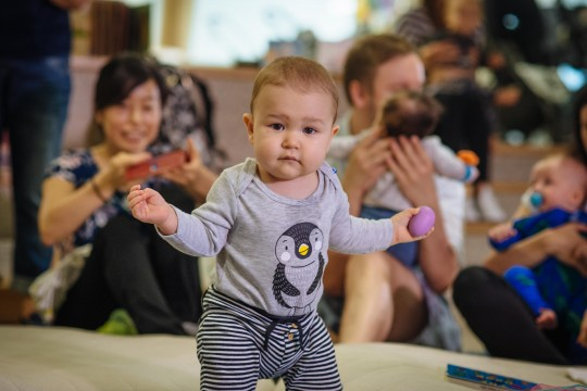 Baby in penguin top dancing at Rhyme Time