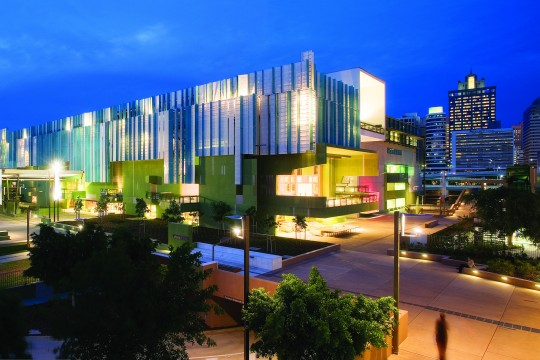 State Library of Queensland building lit up at night