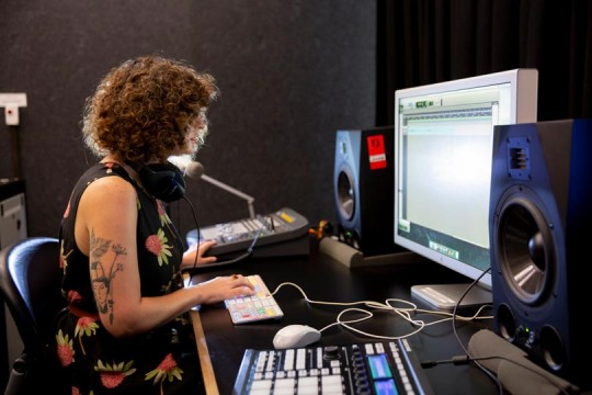 Woman mixing sound in the Edge recording studio