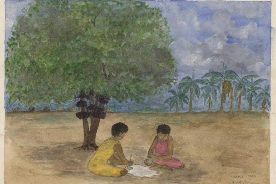 Two children sitting under a tree playing with spinning tops.