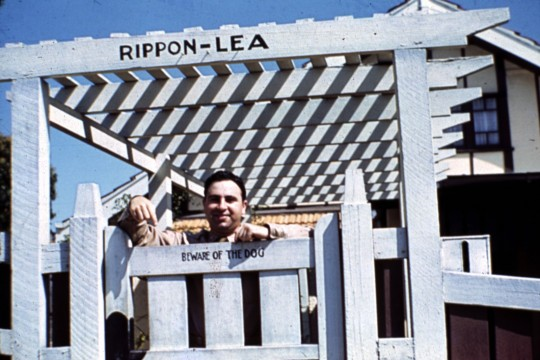American Lieutenant Mark Muller standing at the front gate to his rental house in Hamilton ca 1942