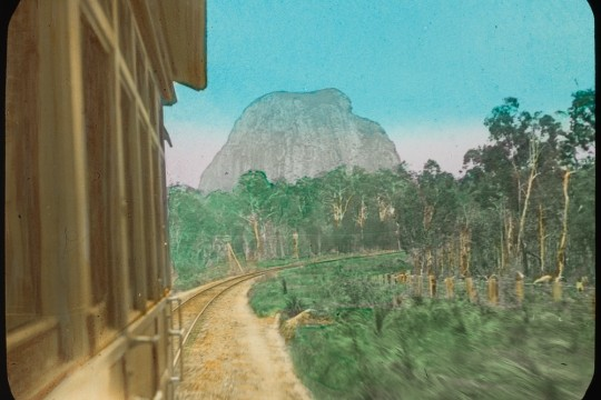 View of Mount Tibrogargan from a railway carriage Glasshouse Mountains Queensland ca 1910