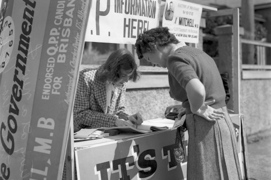 Two women at a voting booth