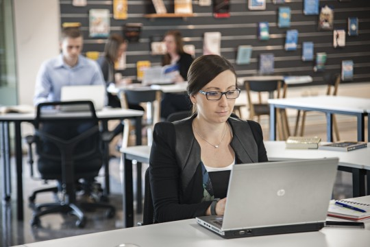 Woman using a laptop in the Business Studio