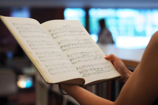 Client perusing music book at the State Library of Queensland. Photo by Emma Winch.