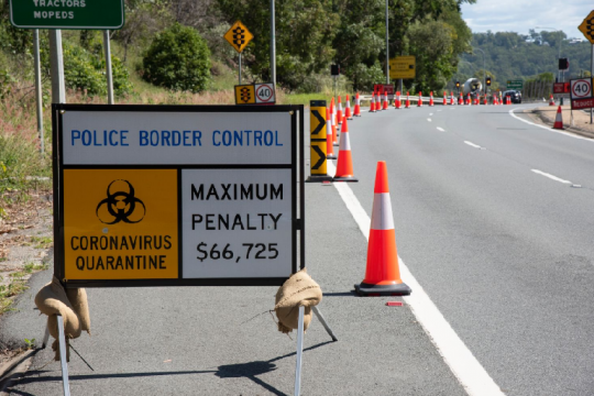 Roadside traffic sign advising of the border control operation during the COVID-19 emergency 2020