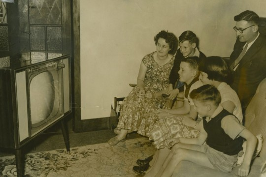 A typical family watching tv in 1959
